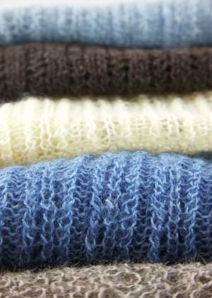 Long wool Wensleydale knitting in blue, brown and grey